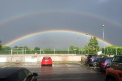 A stunning double rainbow frames the outdoor pitch at DASC, Disley